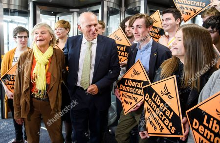 Liberal Democrat leader Vince Cable and his wife Rachel Smith arrive for leaders speech on the final day