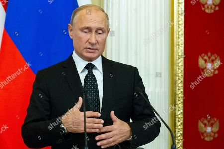 """Stock Photo of Russian President Vladimir Putin gestures while speaking to the media during a joint news conference with Hungarian Prime Minister Viktor Orban after their talks in the Kremlin in Moscow, Russia, . Putin says """"a chain of tragic circumstances"""" is to be blamed for a Russian military aircraft shot down by a Syrian missile. He vowed to boost security for Russian troops there"""