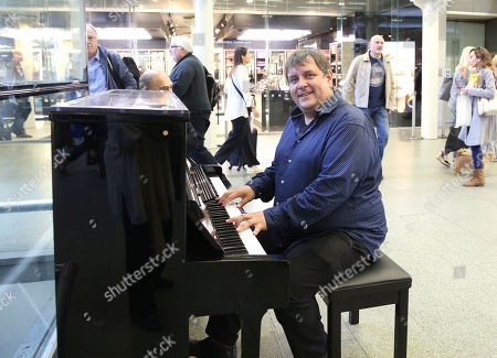 Stock Picture of Top boogie woogie player Ben Waters playing piano at St Pancras