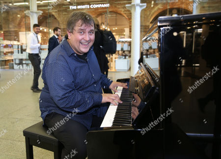 Top boogie woogie player Ben Waters playing piano at St Pancras
