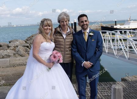 Theresa May gatecrashes couple's wedding photos, Cowes
