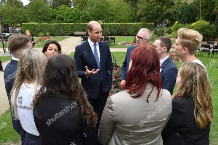 Prince William speaks with Holocaust Educational Trust regional ambassadors before unveiling a new sculpture of Major Frank Foley by artist Andy de Comyn.