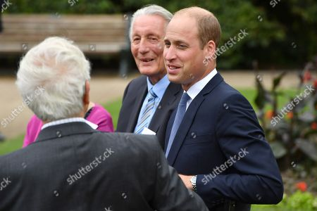 Prince William speaks with families of those helped by Major Frank Foley before unveiling a new sculpture of Major Foley by artist Andy de Comyn.