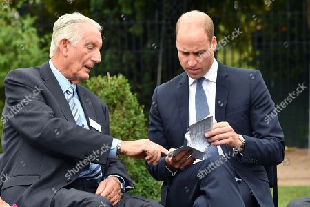 Prince William speaks with Michael Mamelock and views his emigration papers as he meets families of those helped by Major Frank Foley before unveiling a new sculpture of Major Foley by artist Andy de Comyn.