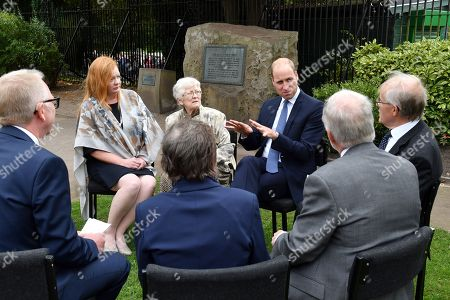 Stock Picture of Prince William speaks with families of those helped by Major Frank Foley before unveiling a new sculpture of Major Foley by artist Andy de Comyn.