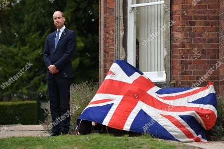 Prince William listens to a speech before unveiling a new sculpture of Major Frank Foley by artist Andy de Comyn. Major Foley was a British Intelligence Officer for the Embassy in Berlin where he bent the rules to allow thousands of Jewish families escape Nazi Germany