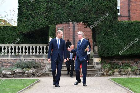 Prince William speaks with Ian Austin MP after unveiling a new sculpture of Major Frank Foley by artist Andy de Comyn. Major Foley was a British Intelligence Officer for the Embassy in Berlin where he bent the rules to allow thousands of Jewish families escape Nazi Germany