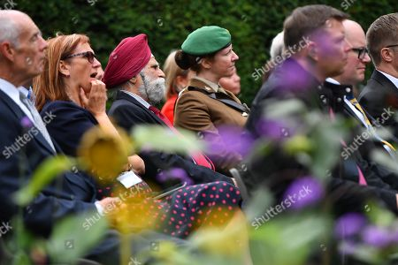Guests look-on as Prince William unveils a new sculpture of Major Frank Foley by artist Andy de Comyn. Major Foley was a British Intelligence Officer for the Embassy in Berlin where he bent the rules to allow thousands of Jewish families escape Nazi Germany.
