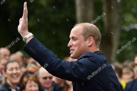 Prince William waving to members of the public after unveiling a new sculpture of Major Frank Foley by artist Andy de Comyn. Major Foley was a British Intelligence Officer for the Embassy in Berlin where he bent the rules to allow thousands of Jewish families escape Nazi Germany.