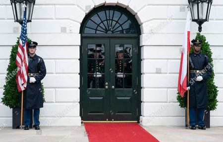 Marine guards await the arrival of United States President Donald J. Trump, First Lady Melania Trump, the President of the Republic of Poland Andrzej Duda and Mrs. Agata Kornhauser-Duda to The White House