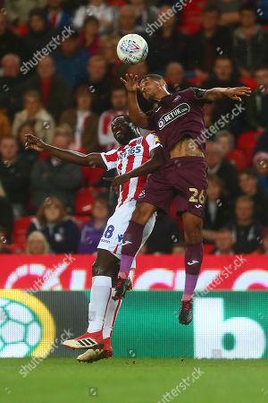 Stoke's Mame Biram Diouf and Swansea's Kyle Naughton
