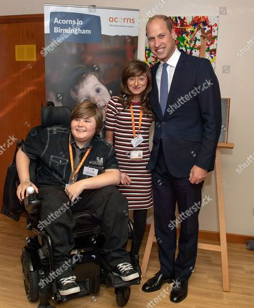 Britain's Prince William meets Acorns Ambassadors Bradley Addison, left and Assya Shabir during his visit to Acorns Children's Hospice in Selly Oak, Birmingham, England, . The hospice provides specialist care for life limited and life threatened children and their families and was opened almost 30 years ago by Diana, Princess of Wales