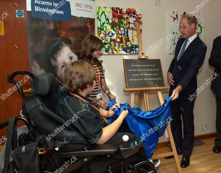 Britain's Prince William unveils a plaque, during a visit to Acorns Children's Hospice in Selly Oak, Birmingham, England, . The hospice provides specialist care for life limited and life threatened children and their families and was opened almost 30 years ago by Diana, Princess of Wales