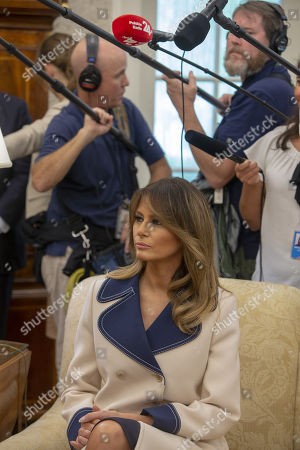 US First lady Melania Trump listens as President of Poland Andrzej Duda and U.S. President Donald Trump meet inside the Oval Office at the White House in Washington, DC, USA,  on 18 September 2018.