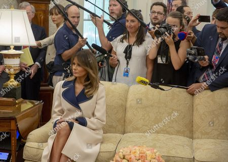 US First Lady Melania Trump listens as President of Poland Andrzej Duda and US President Donald J. Trump meet inside the Oval Office at the White House in Washington, DC, USA,  on 18 September 2018.