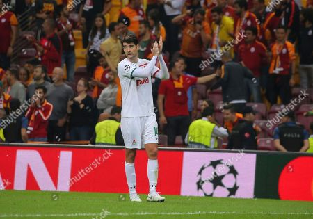 Lokomotiv Moscow's defender Vedran Corluka, applauds following the Champions League Group D soccer match between Galatasaray and Lokomotiv Moscow in Istanbul, . Galatasaray won the match 3-0
