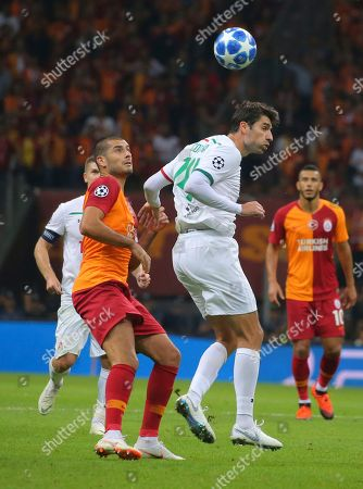 Galatasaray's forward Eren Derdiyok, left, tries to stop Lokomotiv Moscow's defender Vedran Corluka, during the Champions League Group D soccer match between Galatasaray and Lokomotiv Moscow in Istanbul