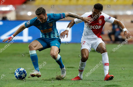 Jordi Mboula of AS Monaco (L) and Saul Niguez Esclapez (R) of Atletico de Madrid (C) in action during the UEFA Champions League Group A soccer match between AS Monaco and Atletico Madrid, at Stade Louis II, in Monaco, 18 September 2018.