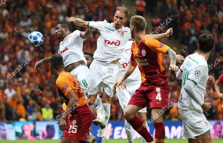 Galatasaray's Serdar Aziz (2-R) and Fernando (L) in action against Lokomotiv Moscow's Jefferson Farfan (2-L) and Benedikt Howedes (C) during the UEFA Champions League Group D soccer match between Galatasaray Istanbul and Lokomotiv Moscow, in Istanbul, Turkey, 18 September 2018.