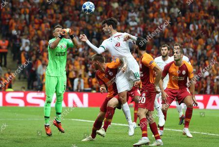 Galatasaray's goalkeeper Fernando Muslera (L) and Serdar Aziz (2-L) in action against Lokomotiv Moscow's Vedran Corluka (C) during the UEFA Champions League Group D soccer match between Galatasaray Istanbul and Lokomotiv Moscow, in Istanbul, Turkey, 18 September 2018.