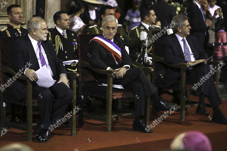 Stock Picture of (L-R) The president of the Senate, Carlos Montes; Chilean President Sebastian Pinera and president of the Supreme Court, Haroldo Brito, participate in a mass on the occasion of the 208th anniversary of Chile's Independence, at the Metropolitan Cathedral of Santiago, Chile, 18 September 2018.