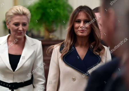 Agata Kornhauser-Duda, Melania Trump. First lady Melania Trump, right, and Polish first lady Agata Kornhauser-Duda, left, arrive for a news conference with their spouses in the East Room of the White House in Washington