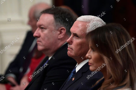 Donald Trump, Andrzej Duda. Vice President Mike Pence, center, flanked by Secretary of State Mike Pompeo, left, and first lady Melania Trump, right, wait for the start of a news conference with President Donald Trump and Polish President Andrzej Duda in the East Room of the White House in Washington