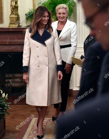 Agata Kornhauser-Duda, Melania Trump. First lady Melania Trump, left, and Polish first lady Agata Kornhauser-Duda, right, arrive for a news conference with their spouses in the East Room of the White House in Washington
