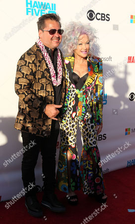 Executive Producer Peter M. Lenkov takes a moment with music icon Cyndi Lauper on the red carpet during the Hawaii Five-O and Magnum P.I. Sunset On The Beach event on Waikiki Beach in Honolulu, Hawaii - Michael Sullivan/CSM