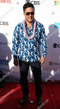 Tim Kang, who plays Detective Gordon Katsumoto on the new Magnum P.I., on the red carpet during the Hawaii Five-O and Magnum P.I. Sunset On The Beach event on Waikiki Beach in Honolulu, Hawaii - Michael Sullivan/CSM