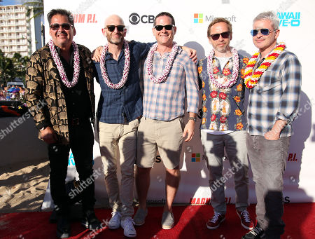Executive producers Peter M. Lenkov (left) and Eric Guggenheim (2nd from left) are joined by others on the red carpet during the Hawaii Five-O and Magnum P.I. Sunset On The Beach event on Waikiki Beach in Honolulu, Hawaii - Michael Sullivan/CSM