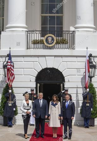 Mrs Kornhauser-Duda, United States President Donald J. Trump, First lady Melania Trump and President of Poland Andrzej Duda pose for the media at the White House