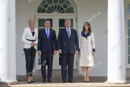 Mrs Kornhauser-Duda, President of Poland Andrzej Duda, United States President Donald J. Trump and First lady Melania Trump pose outside the White House An Oval Office meeting is scheduled.