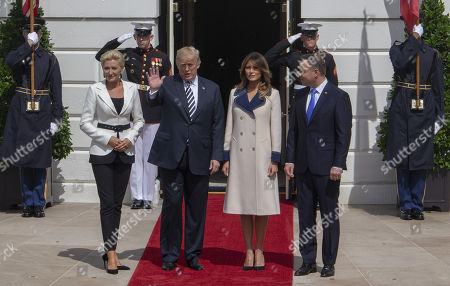 Stock Picture of Mrs Kornhauser-Duda, United States President Donald J. Trump, First lady Melania Trump and President of Poland Andrzej Duda pose for the media at the White House