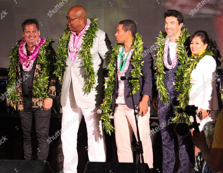 Stock Picture of Left to right, Peter M. Lenkov, Chi McBride, Beulah Koale, Ian Anthony Dale and Kimee Balmilero during the Hawaii Five-O and Magnum P.I. Sunset On The Beach event on Waikiki Beach in Honolulu, Hawaii - Michael Sullivan/CSM