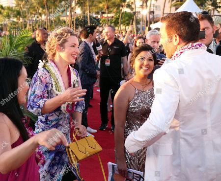 Perdita Weeks greets Alax O'Loughlin during the Hawaii Five-O and Magnum P.I. Sunset On The Beach event on Waikiki Beach in Honolulu, Hawaii - Michael Sullivan/CSM