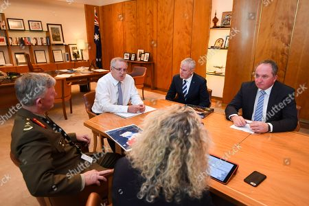 (L-R) Fiona Simson, National drought coordinator Major General Stephen Day, Australian Prime Minister Scott Morrision, Australian Deputy Prime Minister Michael McCormack and Drought Envoy Barnaby Joyce attend during a Drought Response Roundtable at Parliament House in Canberra, Australia, 19 September 2018.