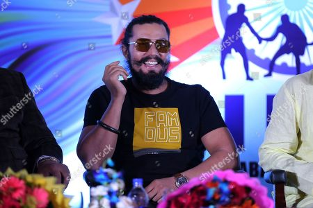 Bollywood actor Randeep Hooda smiles as he listens to a question from a journalist at the launch of Indo International Premier Kabaddi League by the New Kabaddi Federation of India (NKFI) in New Delhi, India