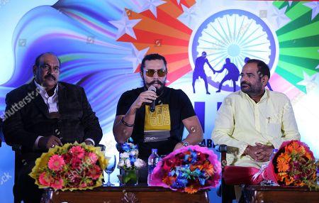 General secretary of New Kabaddi Federation MV Prasad Babu, left, Bhartiya Janata Party leader Ramesh Bidhuri, right, sit beside Bollywood actor Randeep Hooda, center, speaking during the launch of Indo International Premier Kabaddi League by the New Kabaddi Federation of India (NKFI) in New Delhi, India
