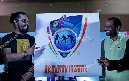 Bhartiya Janata Party leader Ramesh Bidhuri, right, smiles as Bollywood actor Randeep Hooda, left, flashes a victory sign as the logo of Indo International Premier Kabaddi League is unveiled at an event in New Delhi, India, . Indo International Premier Kabaddi League (IIPKL) is launched by the New Kabaddi Federation of India (NKFI