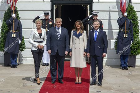 US President Donald J. Trump (2-L) and First Lady Melania Trump (2-R) participate in the arrival of the President of the Republic of Poland Andrzej Duda (R) and his wife Agata Kornhauser-Duda (L), at the South Portico of the White House in Washington, DC, USA, 18 September 2018. Duda and Trump meet to discuss trade, military and security issues.
