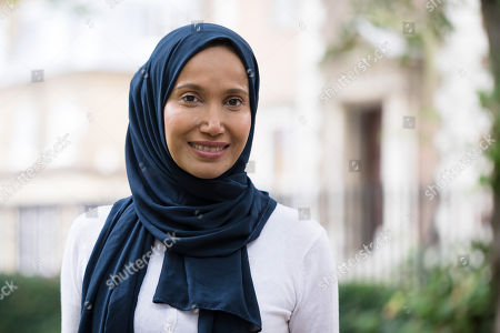 Stock Picture of Writer and politician, Rabina Khan poses for photographs in Wapping, Tower Hamlets the day before announcing that she has joined the Liberal Democrats party.