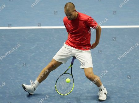 Mikhail Youzhny of Russia returns the ball to Mirza Basic of Bosnia and Herzegovina during the St. Petersburg Open ATP tennis tournament match in St.Petersburg, Russia