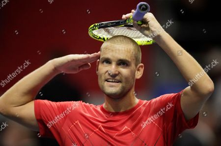Mikhail Youzhny of Russia celebrates his victory over Mirza Basic of Bosnia and Herzegovina in the St. Petersburg Open ATP tennis tournament match in St.Petersburg, Russia