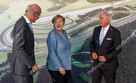 "German Chancellor Angela Merkel (C), Thomas Strobl (R), Christian Democratic Union (CDU) vice-chairman, Dieter Zetsche (L), Chairman of the Board of Management of Daimler AG and Chief Executive Officer of Mercedes-Benz Cars, attend the inauguration of Daimler Test and Technology Centre in Immendingen, Germany, 19 September 2018. On the 520-hectare site of Daimler Test and Technology Centre in Immendingen, more than 300 employees will be working on testing assistance systems, autonomous driving functions and electric vehicles of the ""EQ"" product and technology brand, among other things."