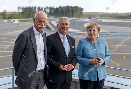 Dieter Zetsche (L), Chairman of the Board of Management of Daimler AG and Chief Executive Officer of Mercedes-Benz Cars, German Chancellor Angela Merkel (R) and Thomas Strobl (C), Christian Democratic Union's (CDU) vice-chairman during the inauguration of Daimler Test and Technology Centre in Immendingen, Germany, 19 September 2018. On the 520-hectare site of Daimler Test and Technology Centre in Immendingen, more than 300 employees will be working on testing assistance systems, autonomous driving functions and electric vehicles of the EQ product and technology brand, among other things.