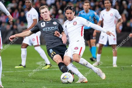 Melbourne City midfielder Riley McGree (8) fights Western Sydney Wanderers defender Raul Llorente (24) for the ball at the FFA Cup quarter-final soccer match between Melbourne City FC and Western Sydney Wanderers FC at AAMI Park in Melbourne.
