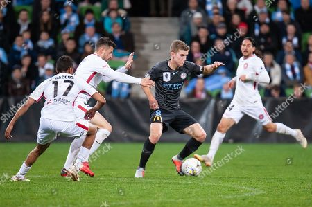 Melbourne City midfielder Riley McGree (8) controls the ball against Western Sydney Wanderers players at the FFA Cup quarter-final soccer match between Melbourne City FC and Western Sydney Wanderers FC at AAMI Park in Melbourne.