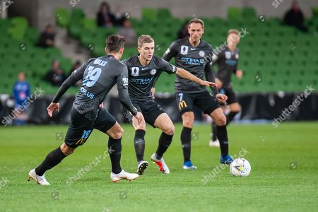 Melbourne City midfielder Riley McGree (8) defends the ball from Western Sydney Wanderers defender Brendan Hamill (5) at the FFA Cup quarter-final soccer match between Melbourne City FC and Western Sydney Wanderers FC at AAMI Park in Melbourne.