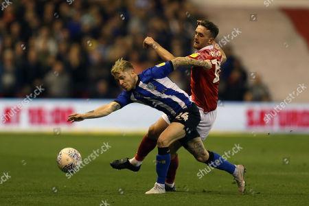 Nottingham Forest's Jack Robinson battles with Sheffield Wednesday's Ashley Baker